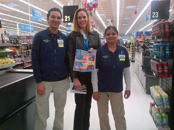 laura-phillips-stops-in-a-walmart-store-to-help-prepare-merchandise-for-black-friday(3)